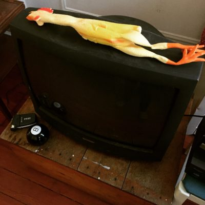 Rubber chicken and an old CRT television. Can't get much better set design than this.