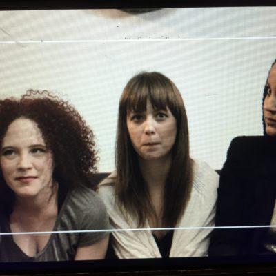 Sarah Schoofs, Lauren A. Kennedy,  and Rory Lipede on the monitor between takes. SOMEONE is trying to stifle a laugh.